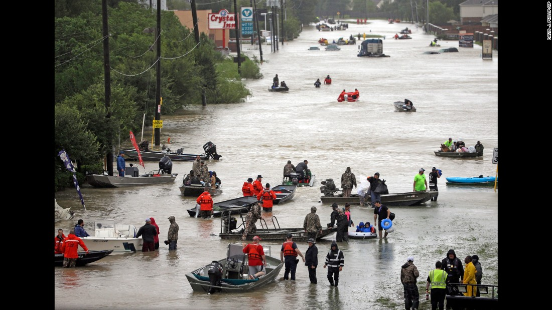 Image result for images of small boats saving victims of Harvey