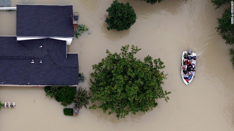Residents evacuate their homes near Houston's  Addicks Reservoir earlier this week.