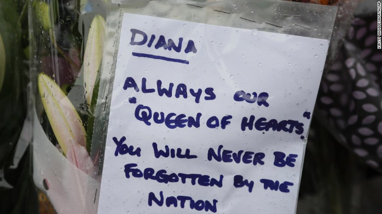 A tribute is attatched to the gates of Kensington Palace in London on Wednesday.