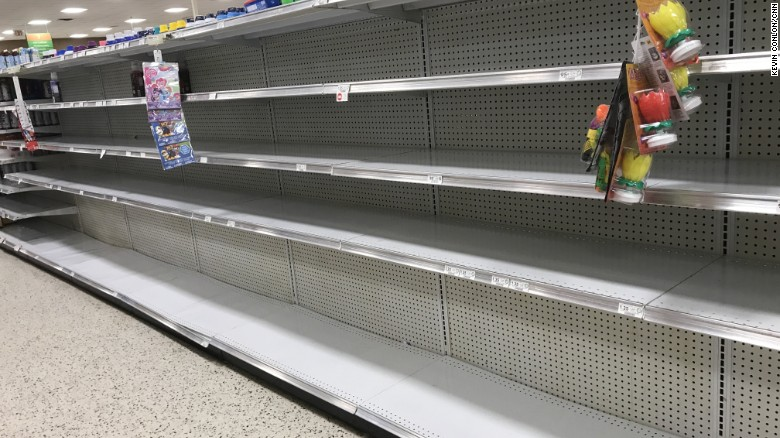 At a Miami Beach Publix grocery store, the water aisle had been cleaned out as Hurricane Irma approached.