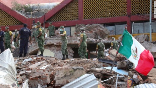 "Soldiers remove debris from a partially collapsed municipal building in Juchitan, Mexico, on Friday, September 8. <a href=""http://www.cnn.com/2017/09/08/americas/earthquake-hits-off-the-coast-of-southern-mexico/index.html"" target=""_blank"">A magnitude-8.1 earthquake</a> was registered the night before off Mexico's southern coast. It is the strongest quake to hit the country in 100 years, according to President Enrique Peña Nieto."