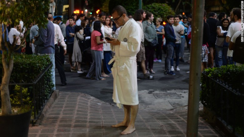 People gather on a street in downtown Mexico City during the quake.