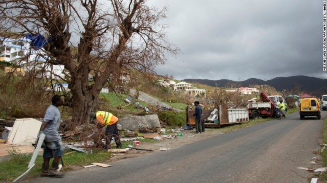 Workers remove debris on Thursday, September 14, in Friars Bay on the French Caribbean island of Saint Martin.  Hurricane Irma devastated the Caribbean island and others in the region.