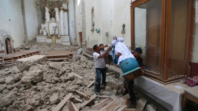 """A religious statue is salvaged from a former convent that was heavily damaged in Tlayacapan, Mexico. This was the second earthquake to hit Mexico in two weeks. A magnitude 8.1 quake <a href=""""http://www.cnn.com/2017/09/08/americas/gallery/mexico-earthquake-2017/index.html"""" target=""""_blank"""">struck off the country's southern coast</a> on September 8."""