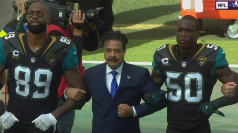 Team owner Shad Khan joined his players in protest Sunday.