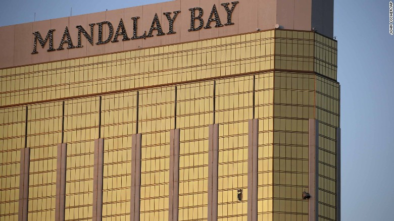 Broken windows of the Mandalay Bay are seen early in Las Vegas on Monday. Police said the gunman fired on the crowd from the 32nd floor of the hotel.