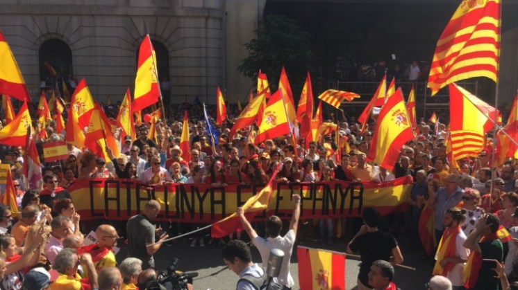 "Protesters hold a banner that reads ""Catalonia is Spain"" at the pro-unity rally in Barcelona on Sunday."