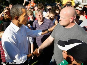 Barack Obama, left, shakes hands with 'Joe the Plumber' Wurzelbacher at a Sunday campaign event.