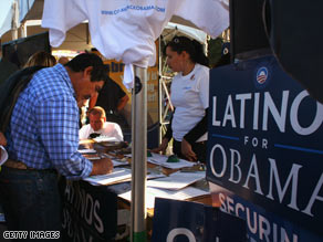 A new voter registers at a Democratic Party booth in September in Denver, Colorado.