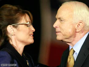 Sen. John McCain and Gov. Sarah Palin embrace after election results were in November 4.