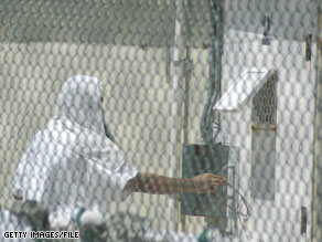 A detainee is seen through a fence in July at the U.S. prison camp at Guantanamo Bay, Cuba.