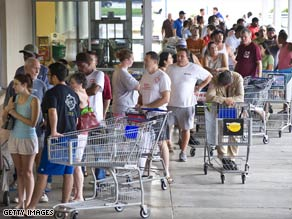 Fearing food shortages, customers line up to buy groceries in League City, Texas, on Sunday.