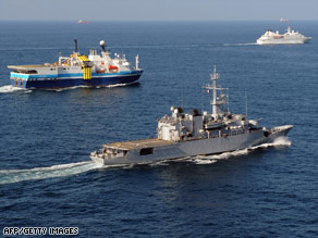 A French frigate, center, escorts ships off the coast of Djibouti to protect them from piracy last month.