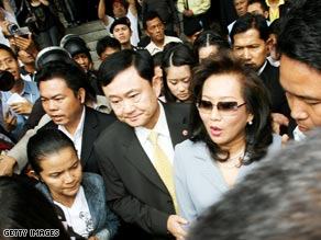 Pojaman Shinawatra and her husband Thaksin leave Bangkok Criminal Court on July 31 in Bangkok, Thailand.
