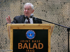 U.S. Defense Secretary Robert Gates speaks to U.S. troops at Joint Base Balad in Iraq on Saturday.