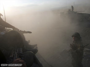 Russian soldiers take position during clashes in South Ossetia in Georgia on Monday.