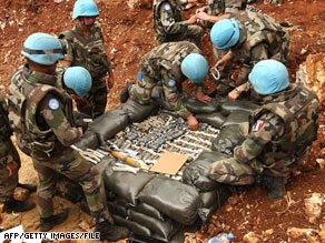 French troops examine cluster bombs collected after the Lebanon conflict of 2006.