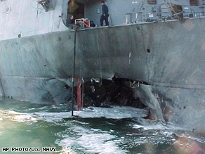Damage sustained by the USS Cole after a bomb exploded on Oct. 2000.