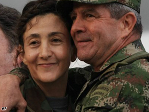 The commander of Colombia's Army, Gen. Mario Montoya, embraces former hostage Ingrid Betancourt