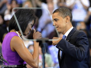 Barack Obama and wife Michelle bump fists on June 3.