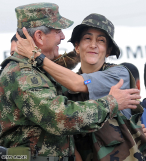 French-Colombian former politician Ingrid Betancourt (R) is hugged by Colombia's Army Gen.Mario Montoya