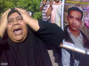 A mother screams following the verdict by an Egyptian court over the 2006 ferry accident in the port city of Safaga, 600km from the capital Cairo on Sunday.
