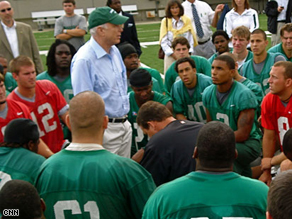 Sen. John McCain gives the Marshall University football team a pep talk during practice, Wednesday.