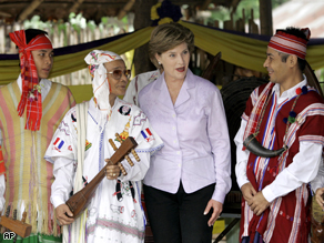 First Lady Laura Bush visits Karen refugees in national costumes during her visit to Mae La refugee camp in Thailand's Mae Sot town, Thursday.