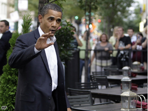 Sen. Barack Obama, D-Ill. waves as he arrives at a restaurant for dinner tonight.