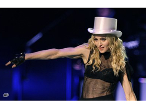 Madonna performs on stage at the premier of her 'Sticky and Sweet' world tour at Cardiff's Millennium Stadium in Wales, Saturday.