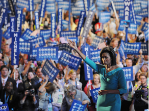 Michelle Obama, wife of Democratic Presidential candidate Barack Obama, acknowledges supporters at the Democratic National Convention 2008, Monday.
