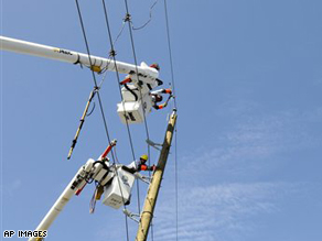 Florida Light and Power Co. linemen work to restore power in the Houston area.