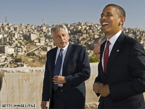 The Obama announced that Sen. Hagel's wife, Lilibet, will join Michelle Obama at the final presidential debate. The two men are pictured in this file photo during Obama's summer Mid East trip.