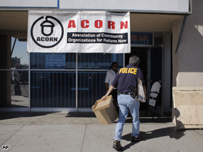 An investigator enters the ACORN office in Las Vegas, Tuesday. A Nevada secretary of state's office spokesman said Tuesday that investigators are looking for evidence of voter fraud at the office.