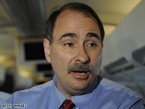 David Axelrod spoke with reporters on board a plane en route to New York Wednesday.