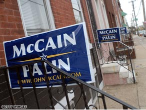 McCain-Palin signs line a row of homes in Philadelphia Tuesday.