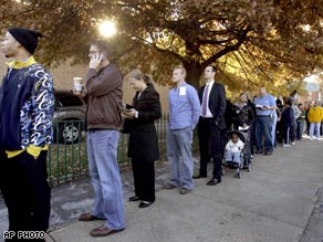 A long line of voters wait patiently outside their polling place to cast their ballots in St. Louis.