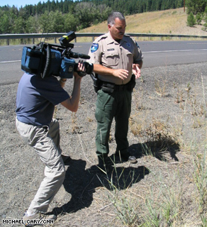 Washington State Dept. of Natural Resources Officer Gary Margheim shows CNN photographer Tom Larson where he found a critical clue -- the arsonist's 'sparking' device.