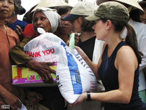 Betty handing out aid on one of her annual humanitarian aid trips to Vietnam.