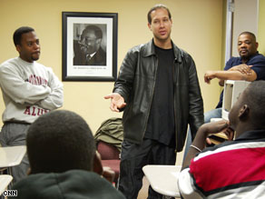Selah speaking with young me n who are members of his non-profit mentoring group, A Guiding Hand