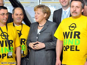 German Chancellor Angela Merkel speaks to employees of German carmaker Opel.