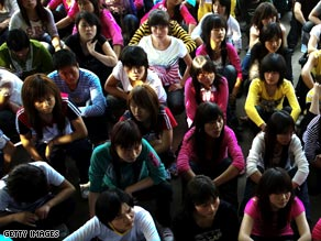 Young migrant workers crowd a Shenzhen human resources office for job placement.