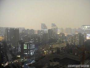 A thunderstorm shrouds Beijing's central business district on Tuesday.