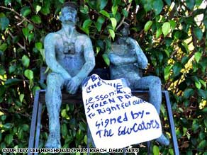 The statue was found with a message apparently aimed at the owner, who is charged with securities fraud.