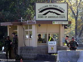 Soldiers stand guard outside Fort Lewis, near Tacoma, Washington, in 2002.