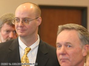 Tim Masters, left, stands with attorney David Wymore, right, before Masters' release from prison last year.