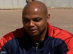 Charles Barkley bristled at the implication he should be wearing stripes instead of a red-and-bue sweatsuit.