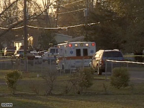 An ambulance rushes to the scene of the multiple shooting in Samson, Alabama, on Tuesday afternoon.