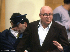 John Demjanjuk appears in court in Jerusalem in 1987 on charges of war crimes and crimes against humanity.