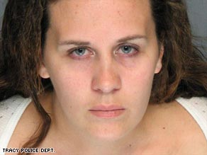 Melissa Huckaby, seen in a mugshot released by police, was arrested in the killing of 8-year-old Sandra Cantu.